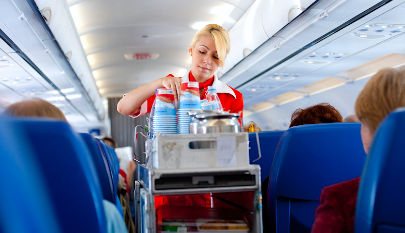 snack and drink service by flight attendant
