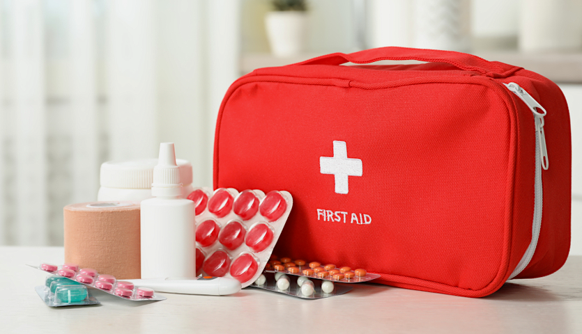 first aid kit with bandages and medicine