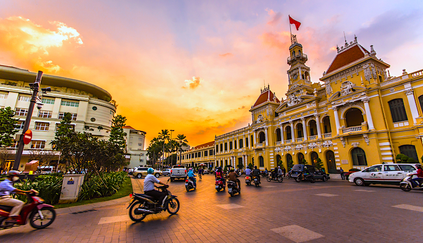 Ho Chi Minh City Town Hall in Vietnam with traffic