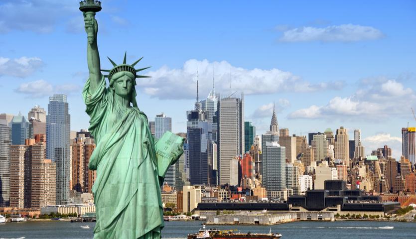 Statue of Liberty overlooking New York Skyline