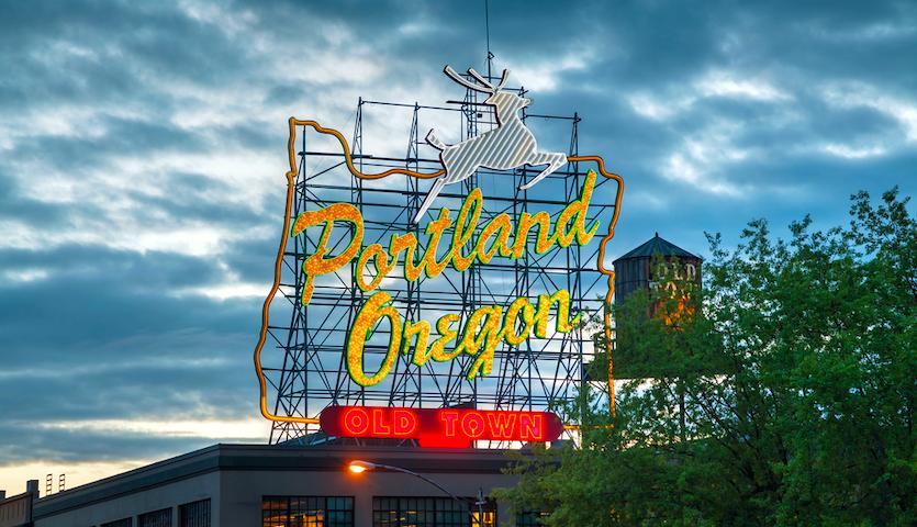 Portland Oregon sign at night lit up