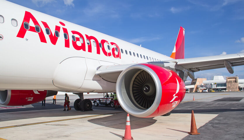 Avianca airplane parked at gate