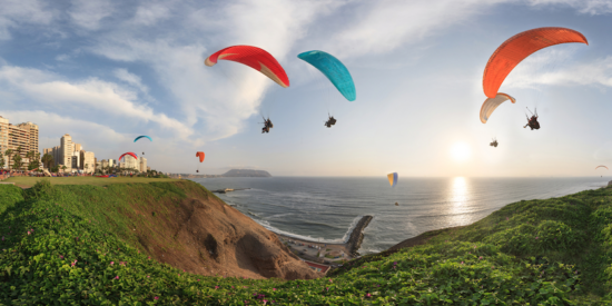 paragliders over the cliffs in lima peru